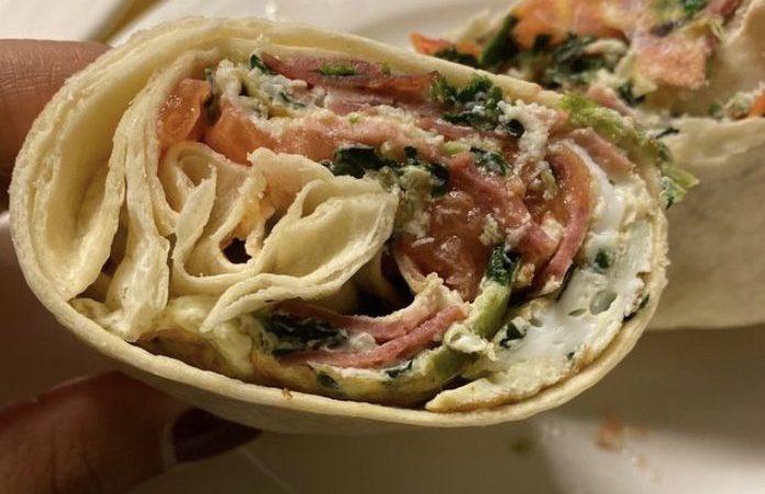 Egg white abdomellete wrap. Four egg whites, turkey breast, spinach and tomato served open face
