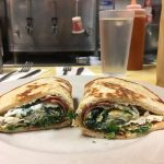 No 25 on a pita. This picture dick pics three egg whites, spinach and turkey bacon on a rolled up pita bread served on a white plate on Johnny's counter